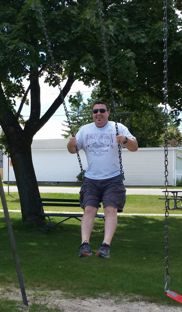 Man swinging on a swing set