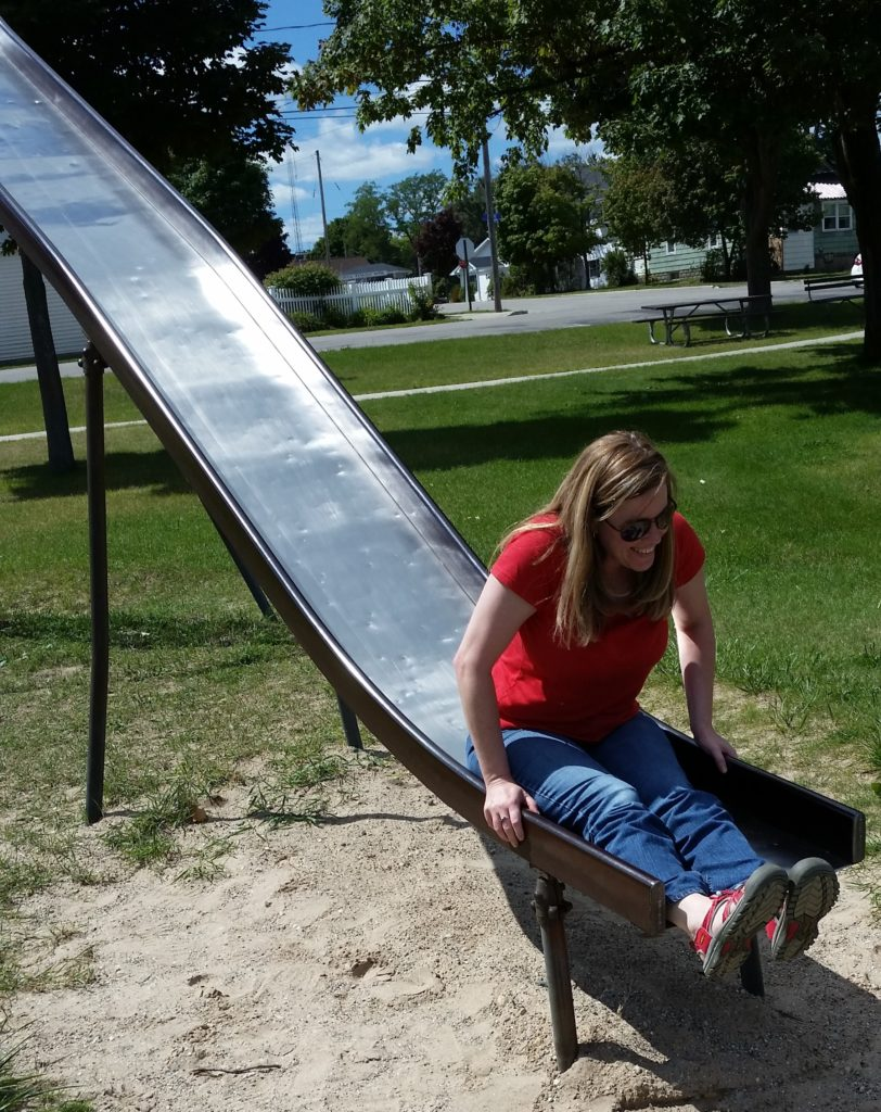 Woman sliding down a slide
