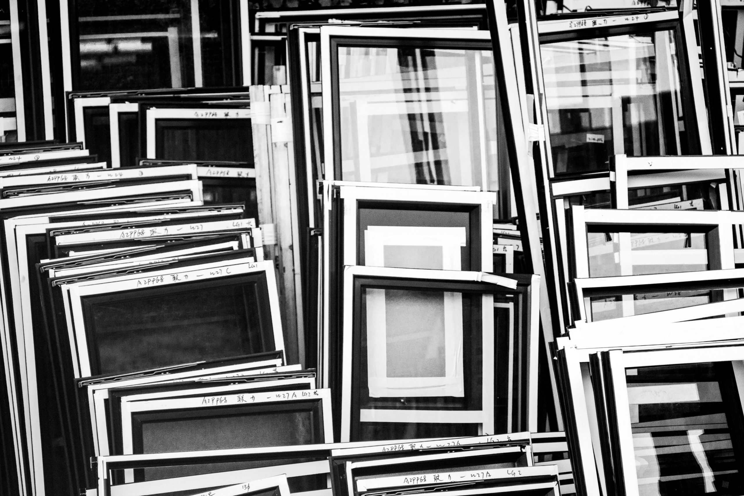 Frames stacked against a building
